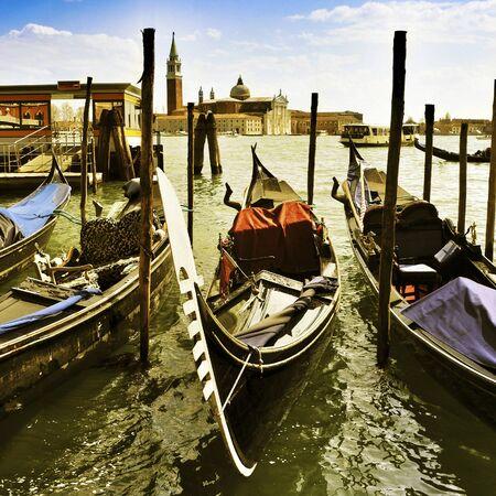 gondolas moored in the lagoon in Venice, Italy, and the Church of San Giorgio Maggiore in the background Stock Photo - 19365569