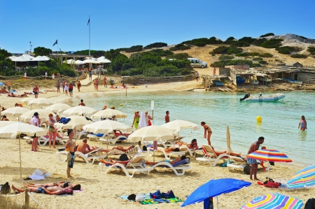 bathers: Formentera, Spain - September 18, 2012: Bathers in Ses Illetes Beach in Formentera, Balearic Islands, Spain. Formentera is renowned across Europe for many white beaches like this