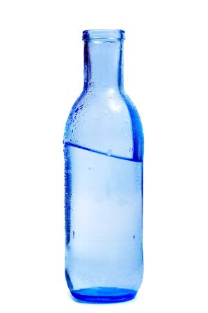 thirstiness: a blue glass bottle of mineral water on a white background