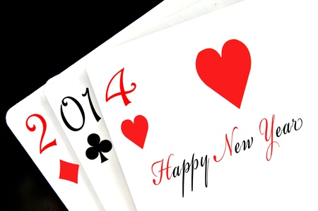 happy new year 2014 written in poker playing cards photo