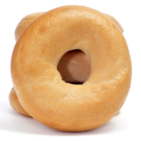 doughy: a pile of plain bagels on a white background Stock Photo