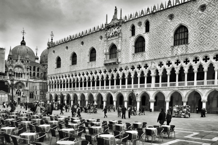Venice, Italy - April 11, 2013: Palazzo Ducale and Basilica di San Marco in Venice, Italy. Formerly the residence of the Doge of Venice, the palace is one of the main landmarks of the city