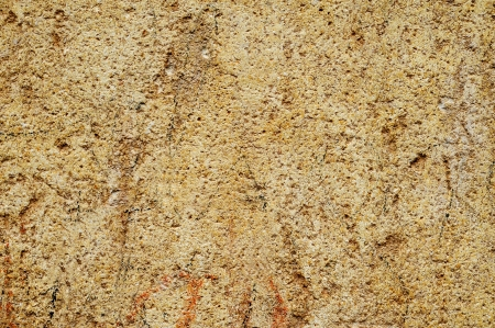 stonemasonry: background made of a close-up of an old stone surface Stock Photo