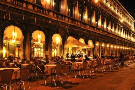 Venice, Italy - April 12, 2013: Caffe Florian in Piazza San Marco at night in Venice, Italy. Caffe Florian, established in 1720, is the oldest coffee house in continuous operation Stock Photo - 19415174