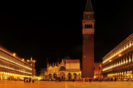 Venice, Italy - April 12, 2013: Ambience in Piazza San Marco at night in Venice, Italy. Piazza San Marco is the main landmark in the city, which receives 18 million tourists per year Stock Photo - 19415173