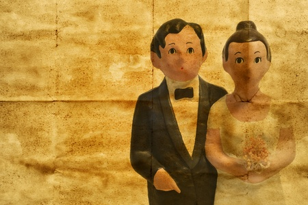 old paper background with a wedding couple simulating a vintage wedding invitation photo