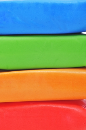 closeup of some bars of rolled fondant of different colors