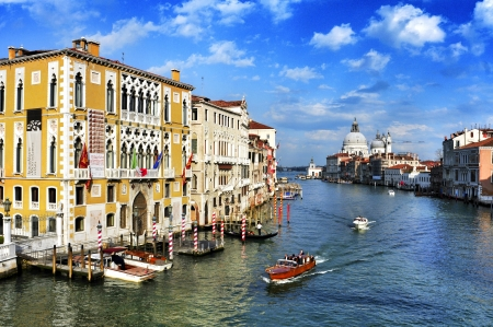 Venice, Italy - April 12, 2013: View of the Grand Canal from Ponte dell Accademia in Venice, Italy. This main canal is 3800 meter long, 30-90 meters wide, with an average depth of 5 meters
