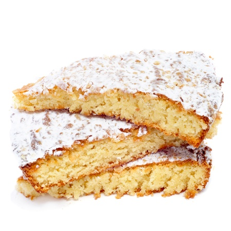 galicia: some pieces of Tarta de Santiago, typical almond pie from Spain, on a white background Stock Photo