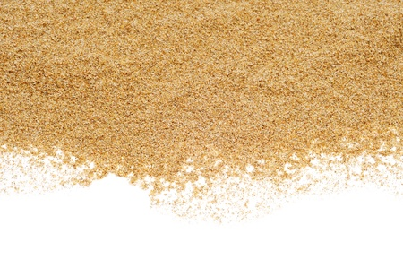 white sand beach: closeup of a pile of sand of a beach or a desert, on a white background Stock Photo