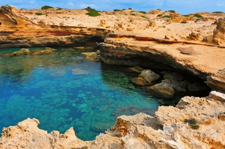 cove: view of a natural pond of seawater in Punta de Sa Pedrera in Formentera, Balearic Islands, Spain