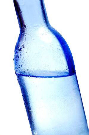 thirstiness: closeup of a bottle of water on a white background Stock Photo