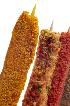 closeup of some raw turkish spiced chicken meat skewers, on a white background photo