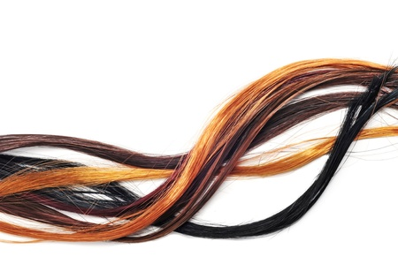 human hair: hair extensions of different colors on a white background Stock Photo