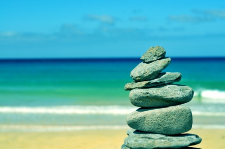 balanced rocks: stack of balanced stones in a white sand beach in Fuerteventura, Canary Islands, Spain Stock Photo