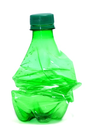 reusing: smashed green plastic bottle, on a white background
