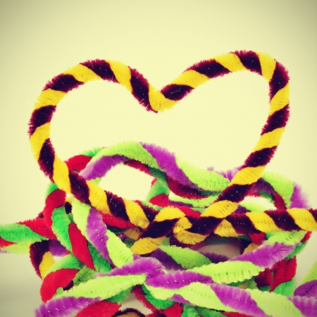 a pile of hearts of different colors made with pipe cleaners, with a retro effect Stock Photo