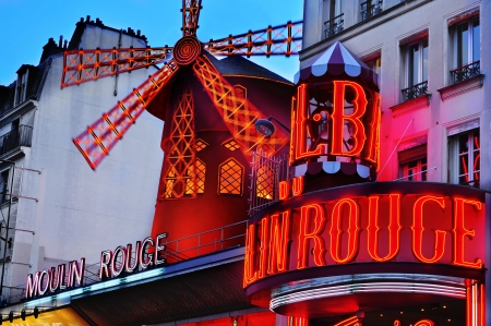 view of the legendary Moulin Rouge in Paris, France, at dusk