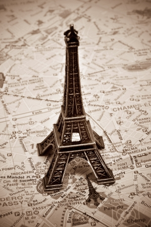 a reproduction of the Eiffel Tower on a map of Paris, with sepia toning photo