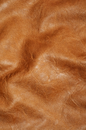 leather background: background made of a closeup of a brown leather texture
