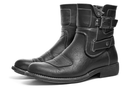 footgear: a pair of black leather boots for men on a white background