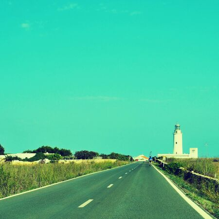 view of beacon Far de la Mola in Formentera, Balearic Islands, Spain, with a retro effect photo