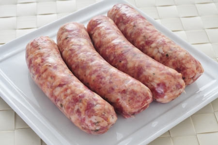 chorizos: closeup of a plate with raw chorizos criollos or chorizos parrilleros, typical latin american sausages made with mixed pork and beef meat