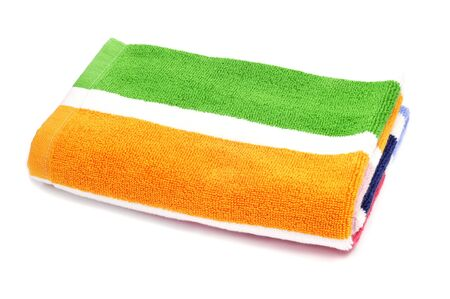 towel beach: a colorful striped beach towel on a white background Stock Photo