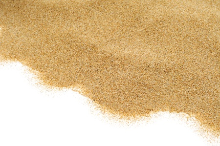 closeup of a pile of sand of a beach or a desert, on a white background Stock Photo