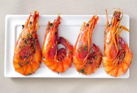 ajillo: closeup of a plate with spanish shrimps cooked with garlic and parsley Stock Photo