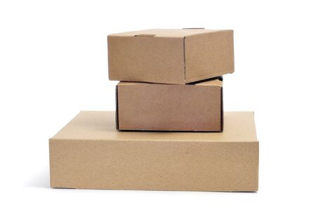 some brown cardboard boxes of different sizes on a white background photo