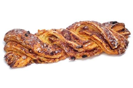 trenzado: un espa�ol Trenza de Almud�var, un pastel t�pico trenzado, sobre un fondo blanco