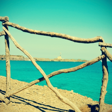 picture of the Mediterranean sea and a typical rustic fence in Menorca, Balearic Islands, Spain, with a retro effect photo