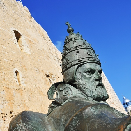 sergio: Peniscola, Spain - July 26, 2013: Sculpture of Benedict XIII in Peniscola, Spain. The statue, designed by Sergio Blanco, is a tribute to Papa Luna, who established the papacy in Peniscola