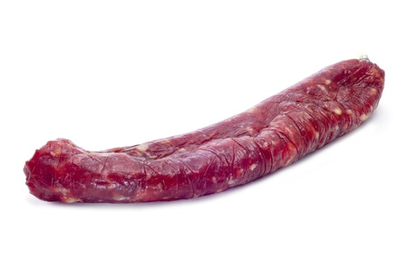 longaniza: fuet, spanish cured sausage typical of Catalonia, on a white background
