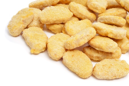 a pile of chicken nuggets on a white background photo