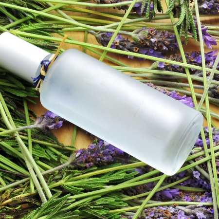 essentials: a bottle with fresh cologne and a pile of lavender flowers