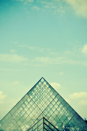 parisian scene: Paris, France - May 17, 2013  Detail of the large glass pyramid of the Louvre Museum in Paris, France  The Louvre Museum is one of the largest museums of the world