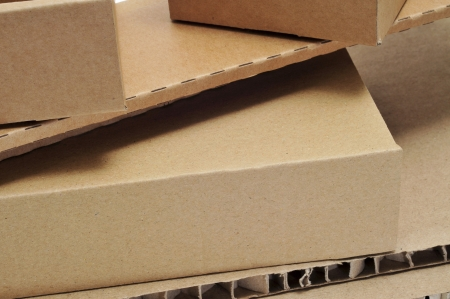 closeup of some brown cardboard boxes and some pieces of corrugated cardboard photo