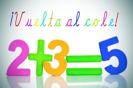 sentence vuelta al cole, back to school in spanish, and the equation two plus three are five with numbers of different colors
