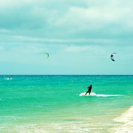 kitesurfers in Sotavento Beach in Fuerteventura, Canary Islands, Spain photo