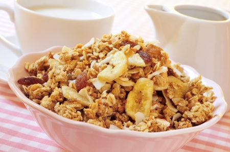 dietary fiber: closeup of a bowl with muesli on a set table for breakfast Stock Photo
