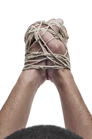 captivity: man with his hands tied with rope, as a symbol of oppression or repression, on a white background Stock Photo