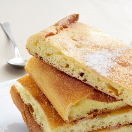 sant: some pieces of coca de sucre, a typical sweet flat cake from Catalonia, Spain Stock Photo