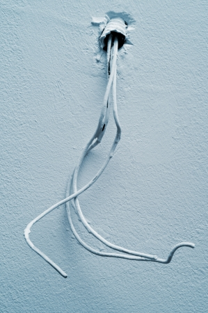 three phase: three-phase electrical cables on a wall or a ceiling Stock Photo