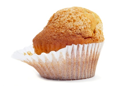 madalena: closeup of a magdalena, a typical spanish plain muffin, detached of the paper cup on a white background Stock Photo