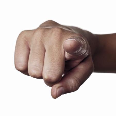 betray: un dedo �ndice de hombre que se�ala al observador en un fondo blanco Foto de archivo