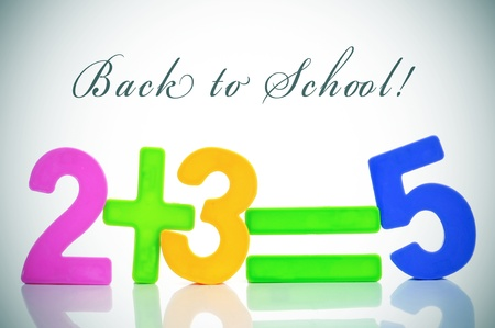 sentence back to school and the equation two plus three are five with numbers of different colors Stock Photo