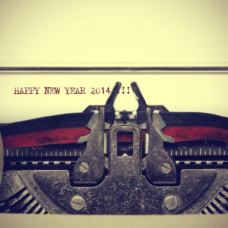 20 year old: happy new year 2014 written with an old typewriter