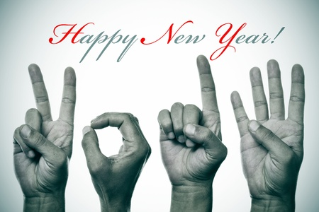 0 1 years: sentence happy new year and hands forming number 2014